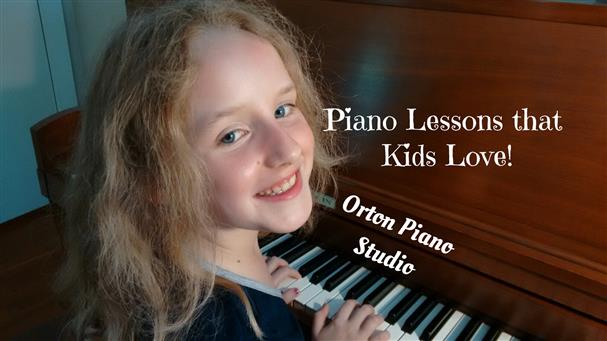 7 Year Old girl smiling at the piano